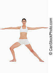 Woman doing the yoga warrior pose