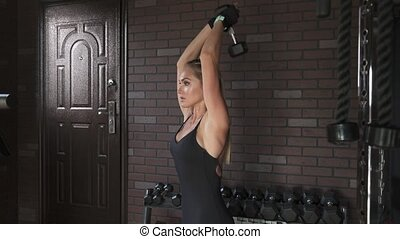 woman doing triceps exercise with dumbbells