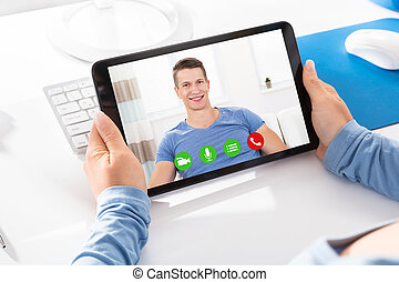 Woman Doing Video Chatting With A Man