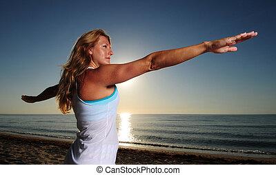 Woman doing Warrior Pose II (Virabhadrasana II)