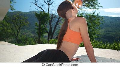 Woman Doing Yoga at terase