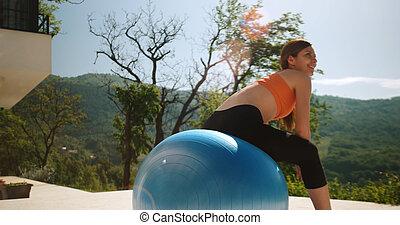 Woman Doing Yoga at villa's terase - Young Woman Doing Yoga...