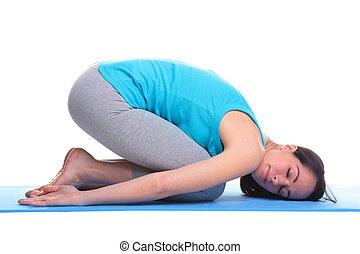 Woman doing yoga balasana - Childs pose - Brunette woman on...
