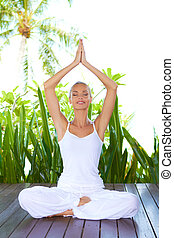 Woman doing yoga breathing exercises - Beautiful smiling...