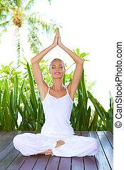 Woman doing yoga breathing exercises - Beautiful smiling...