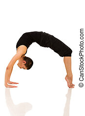 woman doing yoga bridge pose - flexible woman doing yoga...