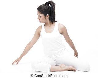 indian philosophy mature man practicing yoga brick wall