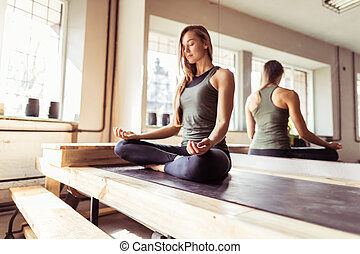 Woman Doing Yoga Exercises In Gym, Sport Fitness Girl...