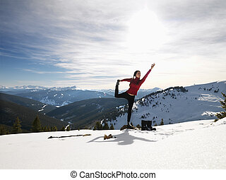 Woman doing yoga in snow. - Young woman doing yoga pose on ...