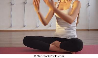 Woman doing yoga in studio.
