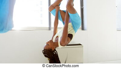Woman doing yoga on hammock 4k - Woman doing yoga on hammock...