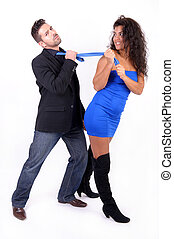 woman dragging a man with his tie