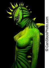 woman-dragon bodyart - painted in the form of a fluorescent...