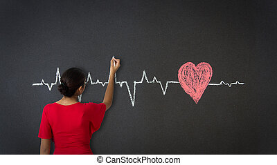 Heartbeat Diagram - Woman drawing a Heartbeat Diagram with...