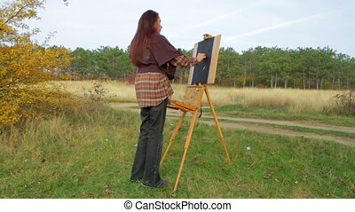 Woman Drawing A Picture At Nature