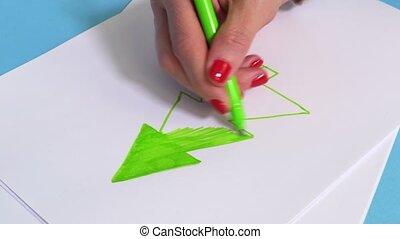 Woman drawing green spruce shape
