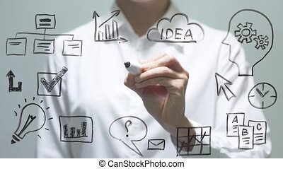 Woman drawing growth graph on transparent screen. Businesswoman draw on board