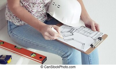 Woman drawing interior design art, using pencil on white...
