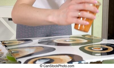 woman draws a picture of a fluid art on canvas 4k