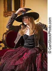 Woman dressed at old fashioned dress with hat