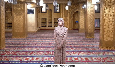 Woman Dressed in a Nun's Robe Stands Inside an Islamic...