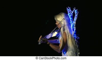 Woman Dressed In A Shining Dress Playing The Violin