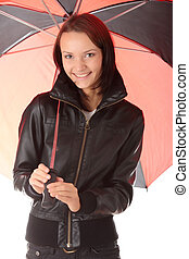 Woman dressed in black under red and black umbrella