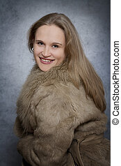 Woman dressed in fur coat