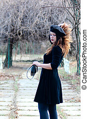 Woman dressed in retro style in a beret
