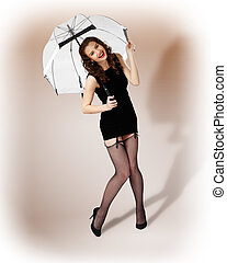 Woman dressed in retro style with umbrella