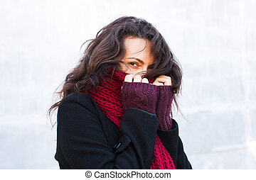 Woman dressed in winter clothes