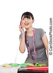 Woman Dressmaker on Phone