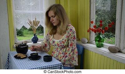 woman drink chamomile tea
