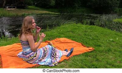 woman drink cider river