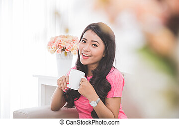 Woman drinking a cup of tea or coffee