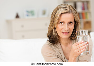 Woman drinking a healthy glass of cold water
