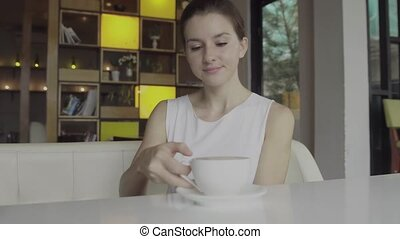 Woman drinking a hot coffee