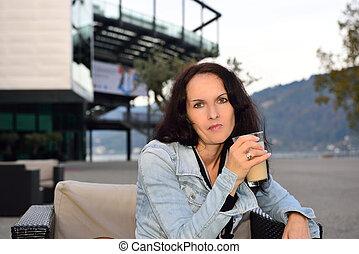 Woman drinking a latte macchiato