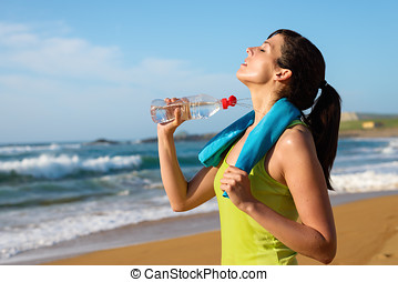 Woman drinking after running