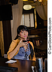 Woman drinking alone at the bar