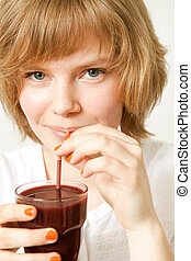 Woman drinking blueberry smoothie - Young beautiful woman...