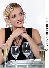 Woman drinking champagne at dinner