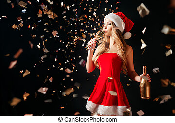 Woman drinking champagne in confetti