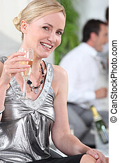 Woman drinking champagne in silver top