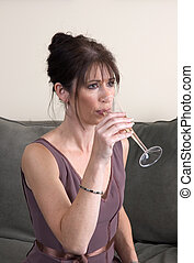 Woman Drinking Champagne on Couch Alone