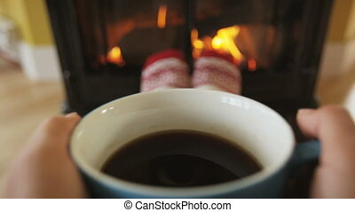 Woman Drinking Coffee By Fireplace During Winter Getting ...