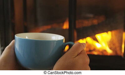 Woman Drinking Coffee Cup By Fireplace In Winter In Slow ...