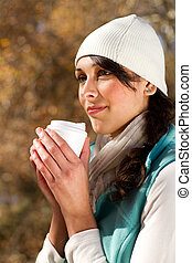 woman drinking coffee in forest
