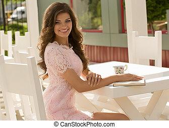 woman drinking coffee in restaurant