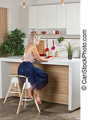 woman drinking coffee in the morning at home